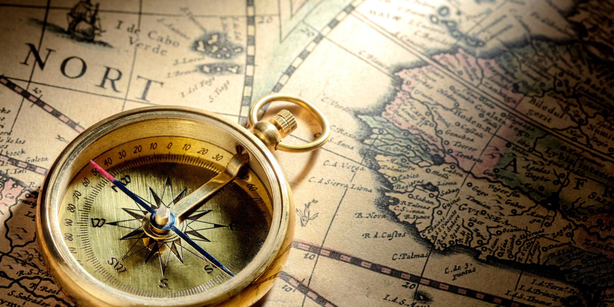 Antique compass on ancient map by H. Hondius dated 1630AD